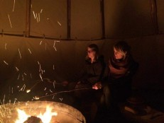 Eating marshmallows in the tipi